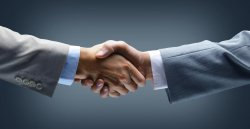 handshake___hand_holding_on_black_background.jpg
